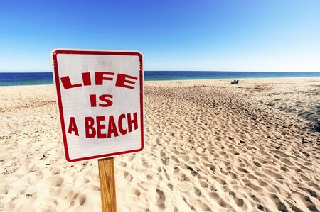 Life is a Beach Sign on Sunny day in Summertime at Sandy Beach