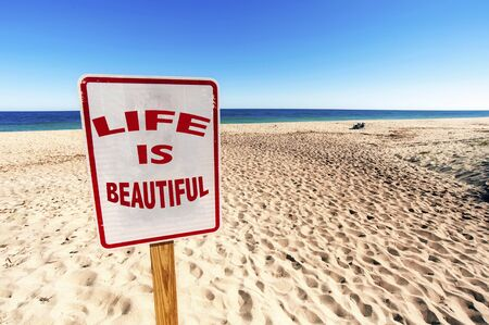 Life is beautiful Sign on Sunny day in Summertime at Sandy Beach