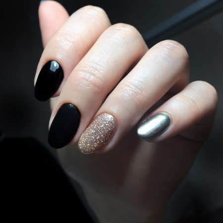 Black female manicure on the nails of a woman