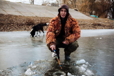 A man is fishing on the ice in the winter. Winter fishing