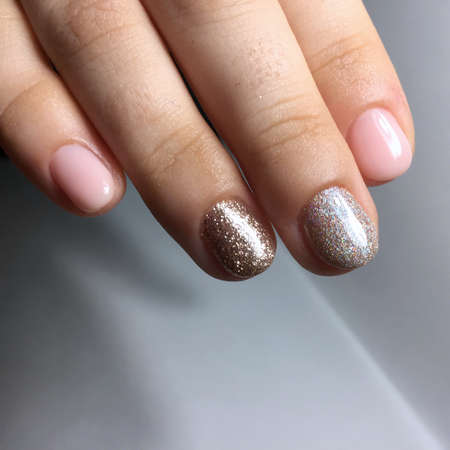 Manicure of different colors on nails. Female manicure