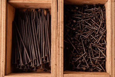 Wooden Boxes with nails and screws close up