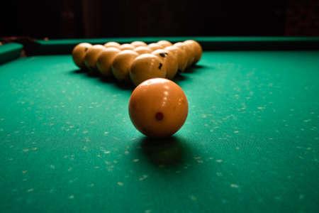 pyramid of billiard balls on the billiard table close up. Billiard balls pool in triangle on green table