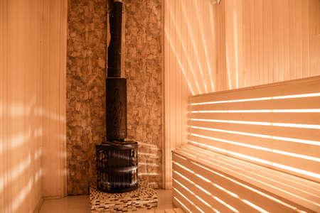 sauna bathhouse warm interior inside empty brooms barrels bucket for water.Sauna interior comfortable wooden room spa indoors