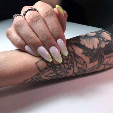 Multicolored manicure close up. Young woman hands with pastel manicure