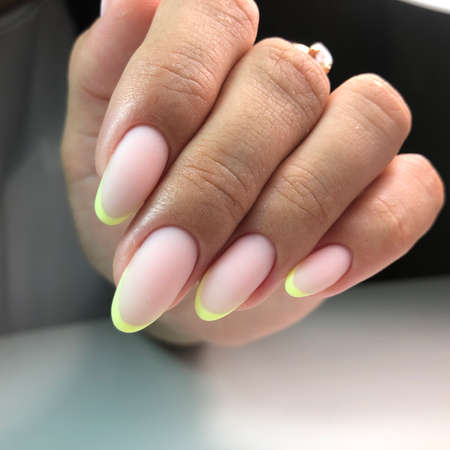 French manicure on the nails.Manicure gel nail polish. Spa and Manicure concept. Female hands with french manicure.
