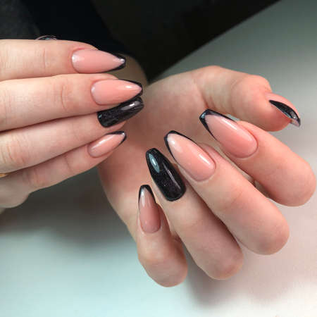 French manicure on the nails.Manicure gel nail polish. Spa and Manicure concept. Female hands with french manicure. Stock Photo