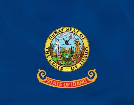 Idaho waving flag. Idaho state flag background texture.Vector illustration. 向量圖像