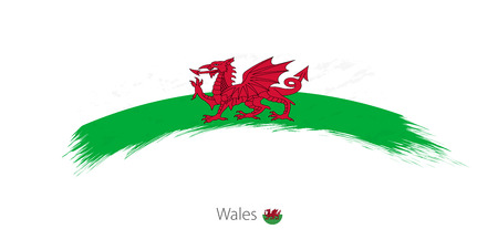 Flag of Wales  in grunge brush stroke Vector illustration.