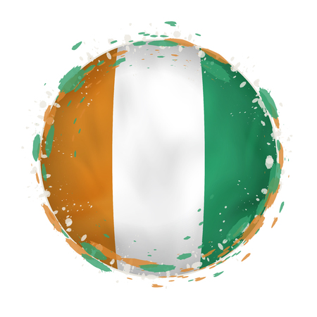 Round grunge flag of Ivory Coast with splashes in flag color. Vector illustration.