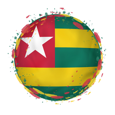 Round grunge flag of Togo with splashes in flag color. Vector illustration. Stock Illustratie