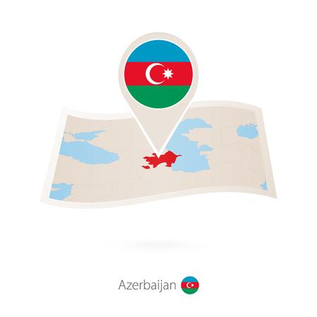 Folded paper map of Azerbaijan with flag pin of Azerbaijan.