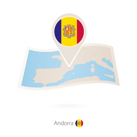 Folded paper map of Andorra with flag pin of Andorra.