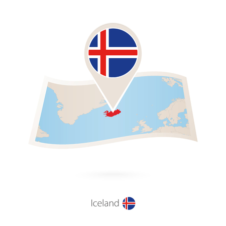 Folded paper map of Iceland with flag pin of Iceland.