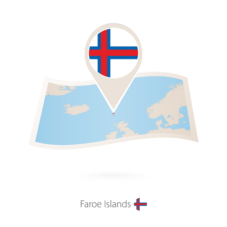 Folded paper map of Faroe Islands with flag pin of Faroe Islands.