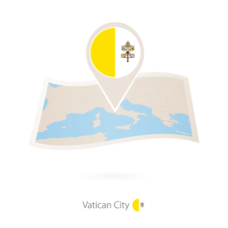 Folded paper map of Vatican City with flag pin of Vatican City.