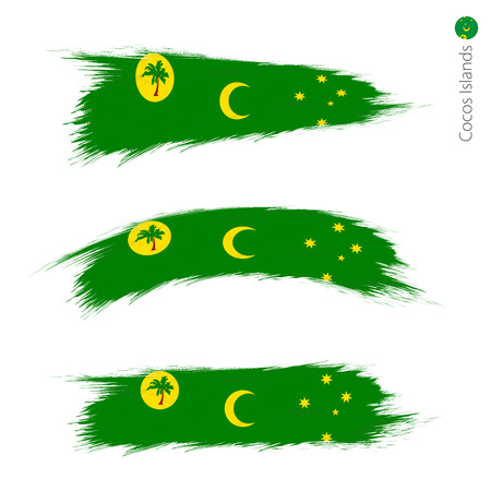 Set of 3 grunge textured flag of Cocos Islands, three versions of national country flag in brush strokes painted style. Vector flags. Çizim