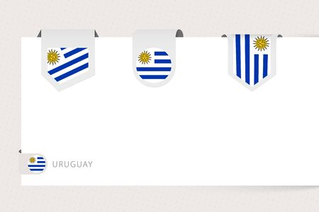 Label flag collection of Uruguay in different shape. Ribbon flag template of Uruguay hanging from paper or different surface.  イラスト・ベクター素材