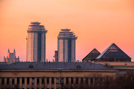 urbanistic: Sunset roofs in Moscow as an outlook from window to the urbanistic landscape