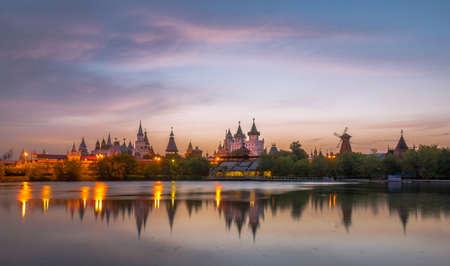 Flying sunset clouds above Izmaylovo Kremlin Stock Photo