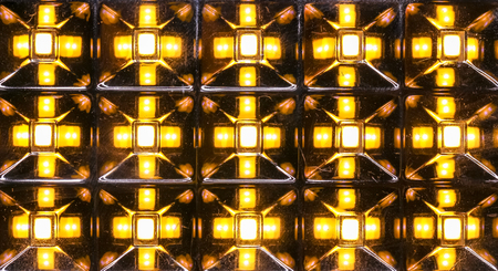 diode: A close up view of a home lamp made of light emitting diode array on reflecting prisms