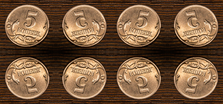five cents: Kaleidoscopic pattern of Russian five cents on textured wooden background