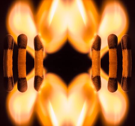 ignited: An abstract symmetrical kaleidoscopic view of ignited matches shaped as flame hearts
