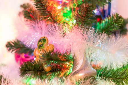 ginger bread man: An abstract picture of happy new year with evergreen tree, toys, ginger bread man and colorful illumination