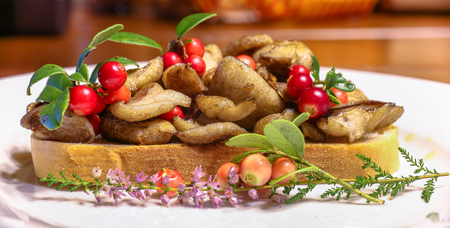 sandwitch: A sandwich with fried wild yellow boletuses and red whortleberry