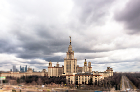 Soften edge cloudy view of Moscow university with heavy autumn clouds Editorial