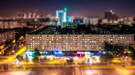 Scenic tilt and shift view of soviet style avenue in Moscow from above tonight