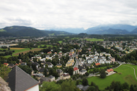 Landscape tilt and shift view of Salzburg buildings among mountains Stock Photo