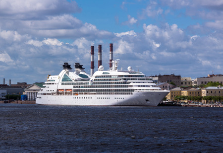 soften: Soften edge envelope size view of large white colored ocean ship in Neva river of Saint Petersburg under blue summer cloudy sky Stock Photo