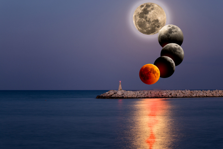 Conceptual compoite image of the stages of the largest lunar eclipse of 21 century  with Moon glade, red Moon and its other photos over Mediterranean Sea near Cyprus Larnaka Stok Fotoğraf