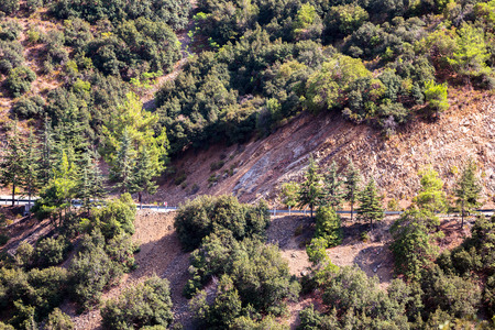 Mountain slopes with trees, terrases and roads in the Troodos region of Cyprus