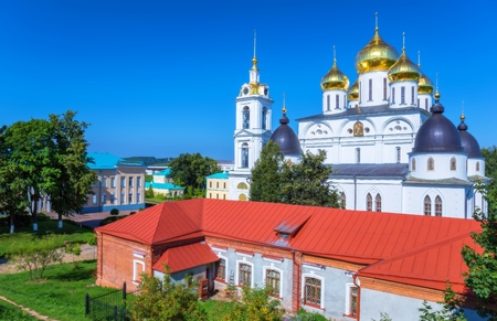 Sunny vbrant view of classical Russian orthodox church under blue sky