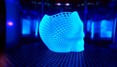 Ultraviolet polymerization of 3D printed glowing skull in mirror sealed chamber Stock Photo