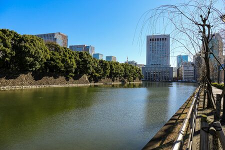 Tokyo sunny cityscape under blue sky with bridges and Sumida river Standard-Bild - 140372375