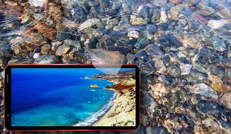 Collage of sunny jellyfish floating in water above Black sea stones and cell phone displaying sunny Cyprus sea landscapes on screen in summer