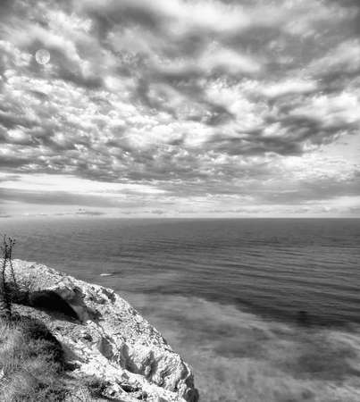 Landscape monochrome view near the birthplace of Aphrodite in Cyprus in summer under dramatic cloudy sky