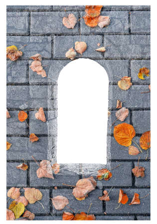 Silhouette of stone window filled with tile stones and fallen golden autumn leaves isolated on white background