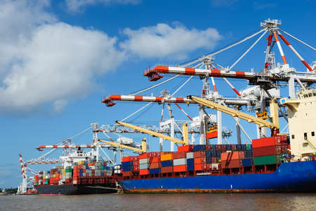 loading cargo: Stacked containers on ship Stock Photo