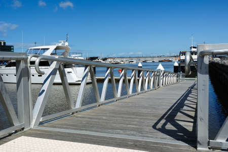 Private yacht docking at a harbour Stock Photo - 10867944