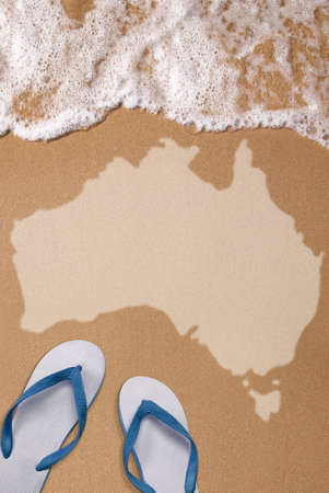 Australian textured map in wet sand on the beach with pair of flip flops Stock Photo - 14065592