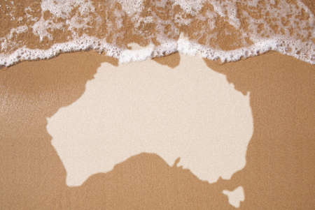 Australian textured map in wet sand  Stock Photo