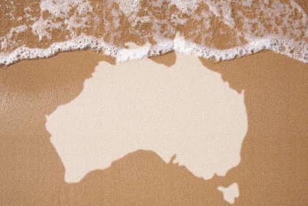 Mapa texturizado australiano na areia molhada
