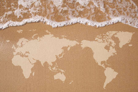 Textured map of the Earth in wet sand  photo