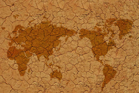 Image of dried soil with flat world map photo