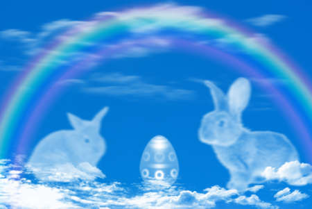 Sky Background with clouds bunnies and Easter egg photo