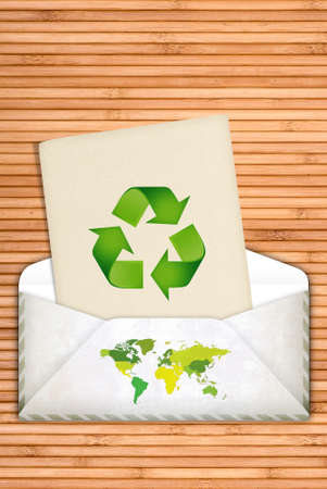 Ecology concept with recycling symbol over wooden background with copy space photo